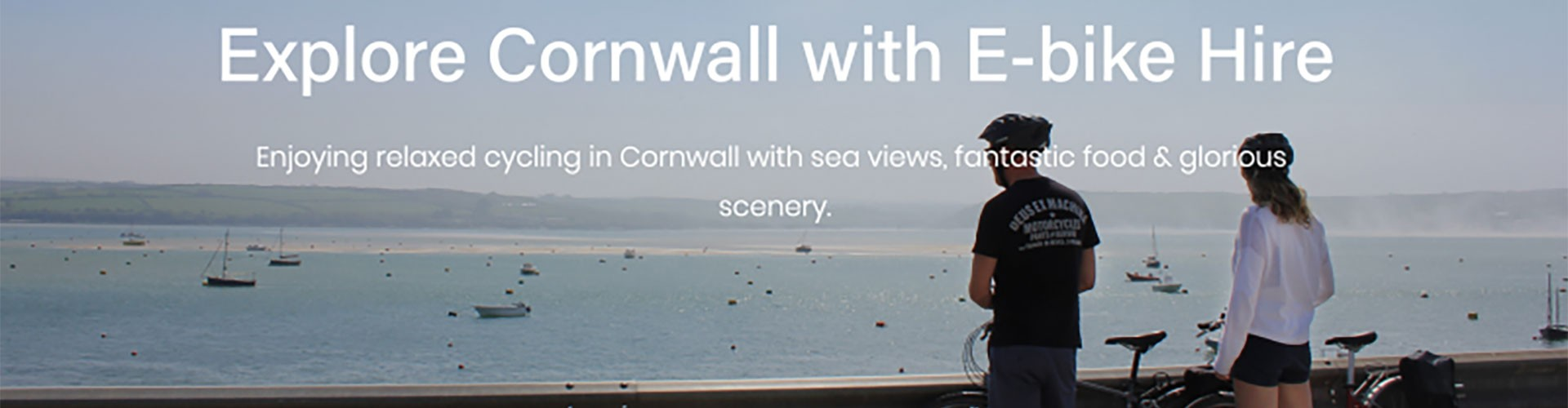 couple looking at Cornish view with bikes