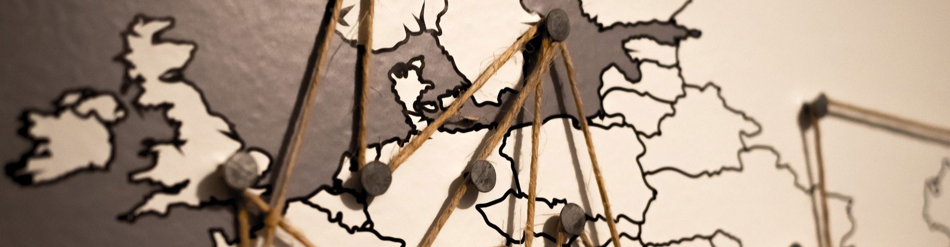 map of Northern Europe with pins and string