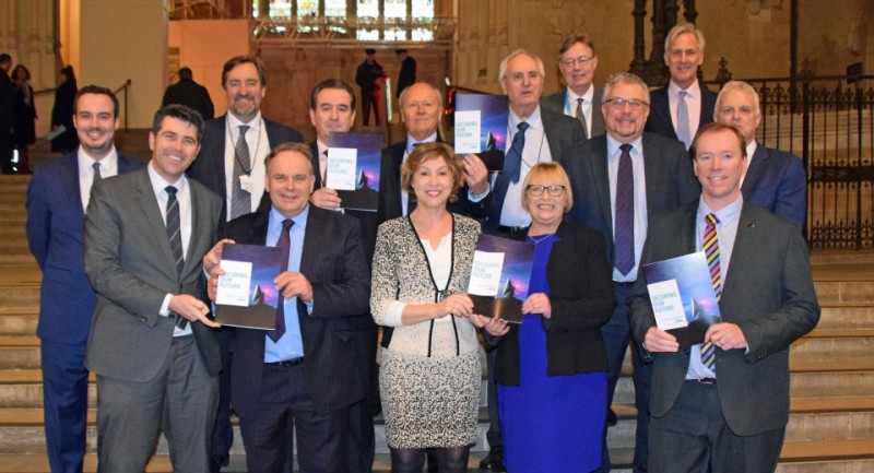 business people and politicians in group posing for camera