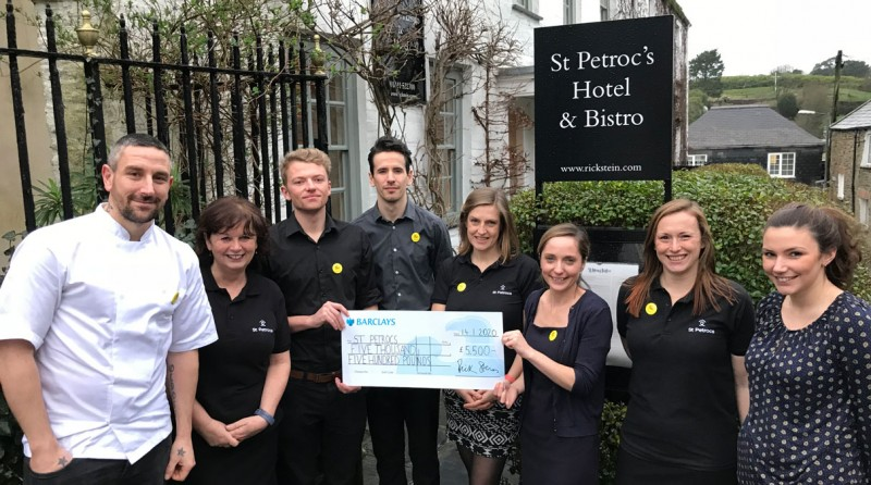 7 st petroc's bistro staff posing with a large cheque
