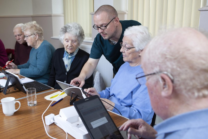 Participants in Smartline learn how to use tablets