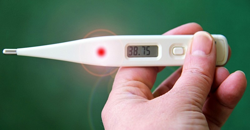 a thermometer showing a fever