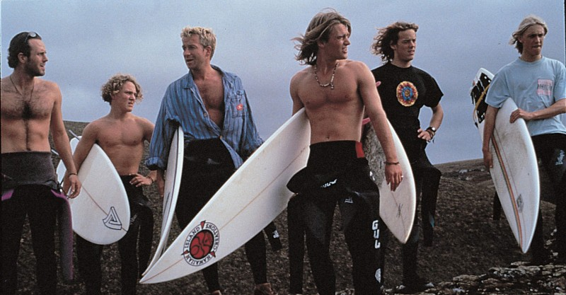 still from film blue juice - surfers holding boards